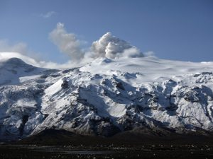 A plume of ash, dust and steam is seen coming from a volcano erupting beneath Iceland's Eyjafjallajokull glacier, Wednesday, April 21, 2010 in Eyjafjallajokull, Iceland. (AP Photo/Carolyn Kaster)